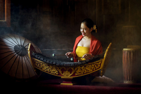 Asian beautiful woman  playing xylophone in thailand. Stock Photo