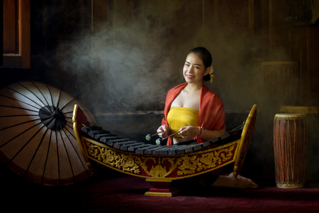 Asian beautiful woman  playing xylophone in thailand. 版權商用圖片