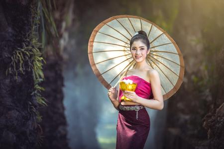 Beautiful Laos girl in Laosi traditional costume at temple. Stock Photo