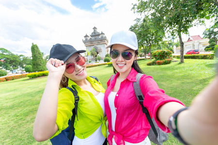 Selfie, Two girlfriends traveling to Patuxai Gate in vientiane,Laos Stock Photo