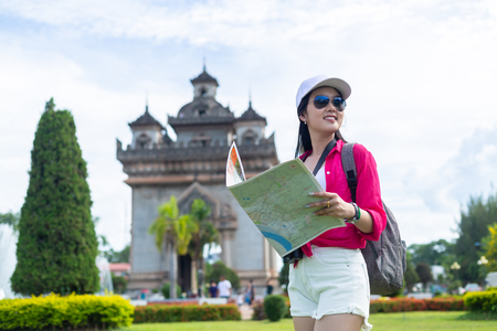 Asian gril traveling to Patuxai Gate in vientiane,Laos