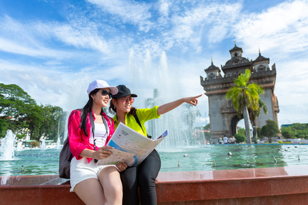 Two girlfriends traveling to Patuxai Gate in vientiane,Laos
