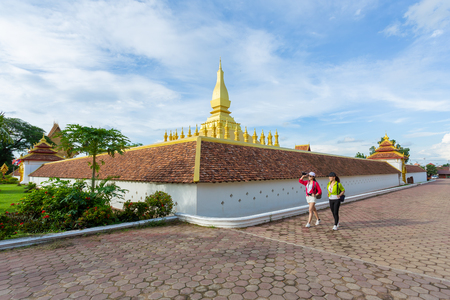 Two girlfriends traveling to Pha That Luang in vientiane,Laos Stok Fotoğraf - 106530681