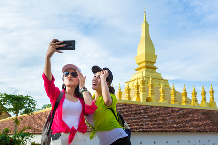 Selfie, Two girlfriends traveling to Wat Phra That Luang in vientiane,Laos Stok Fotoğraf - 106530682