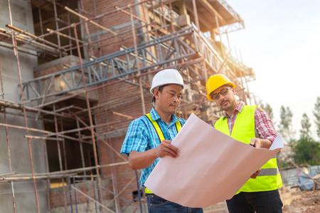 A construction worker control a pouring concrete pump on construction site. Banco de Imagens