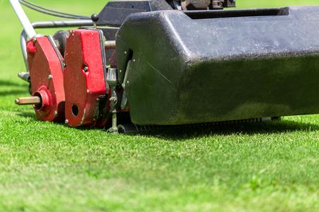 Lawn mower in football field.