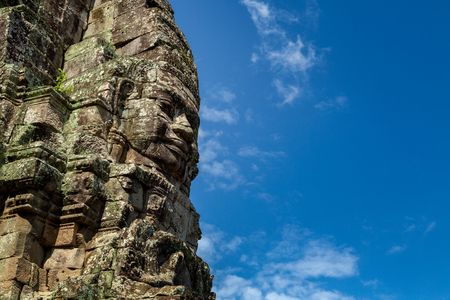 Stone faces on the towers of ancient Bayon Temple in Angkor Wat, Siem reap in Cambodia. Banco de Imagens