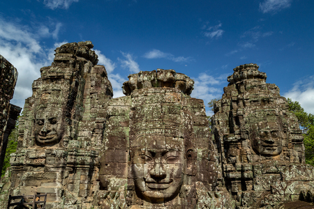 Stone faces on the towers of ancient Bayon Temple in Angkor Wat, Siem reap in Cambodia. 写真素材