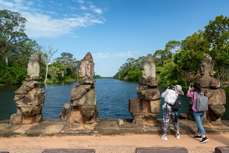 Giants in Front Gate of Angkor Thom, in Angkor Wat, Siem reap in Cambodia. Stock Photo