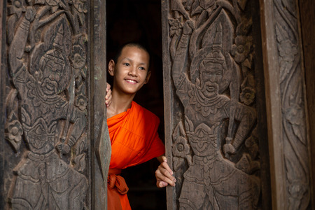 The novice monk opens the door to the idea of opening the mind to learn the world wide.