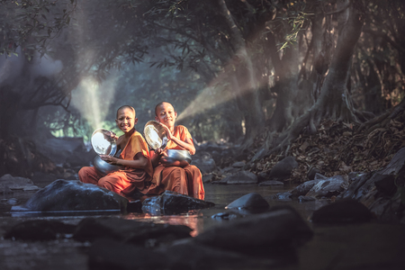 The novice monk rinsed the bowl in a stream and brought the bowl of candles to reflect the sun.