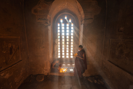 Young Buddhist Novice monk reading in Bagan Myanmar. Stock Photo