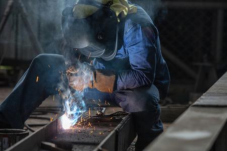 Industrial Worker at the factory Steel welding closeup, Welder
