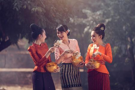Laos girls splashing water during festival Songkran festival