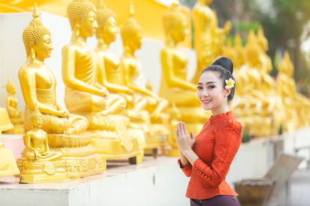Asian woman to pay respect to Buddha statue in thailand. Фото со стока - 109162397