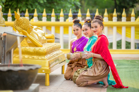 Asian woman are bathing Buddha statue happily in thailand. Stock Photo