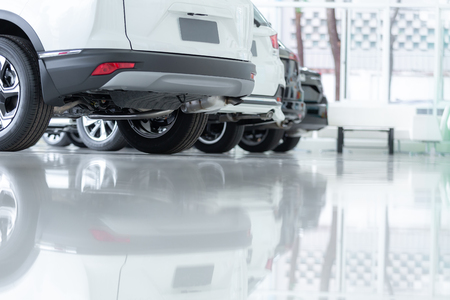 Cars For Sale, Automotive Industry, Cars Dealership Parking Lot. Rows of Brand New Vehicles Awaiting New Owners, on the epoxy floor in new car service Imagens