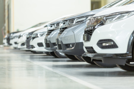 Cars For Sale, Automotive Industry, Cars Dealership Parking Lot. Rows of Brand New Vehicles Awaiting New Owners, on the epoxy floor in new car service Stock fotó