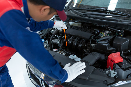 Asian Car Mechanic Detailed Vehicle Inspection. Auto Service Center Theme, Car service center. Stock fotó - 122661332