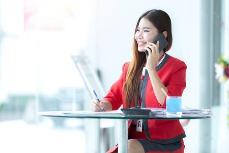 Beautiful Asian Woman With Phone Work Near Business Office. Beautiful Stylish Female Calling On Phone Outdoors.