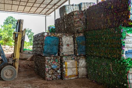 Metal cans and plastic bottles packed to prepare for the recycling plant