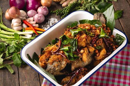 Fried Tubtim fish with herbs for health, [Isan food, Fried fish with herbs, Isan Thai food, Thai food