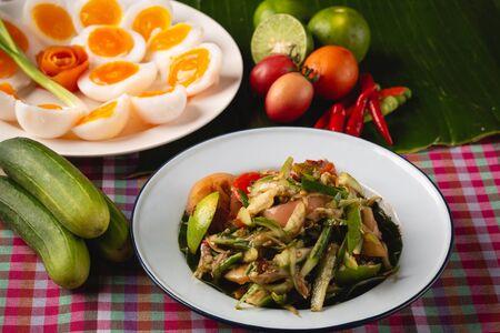 [Thai Esan food] Papaya Salad with boiled egg, Thai Esan local food, Thailand