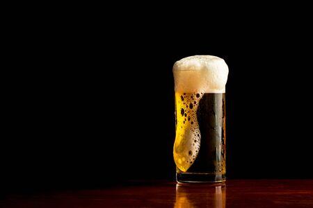 [Beer] mug of beer on dark background, Frosty glass of light beer set. Reklamní fotografie