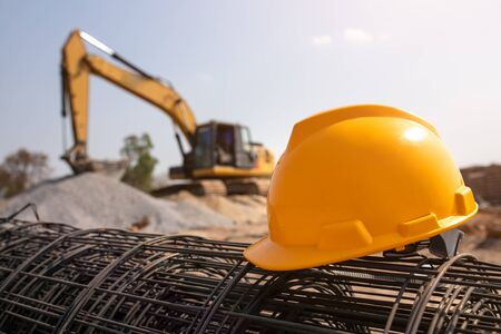 helmet in construction site and construction site equipment in construction new warehouse background Reklamní fotografie