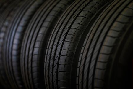 Tire stack background and Selective focus. Car tires at warehouse.