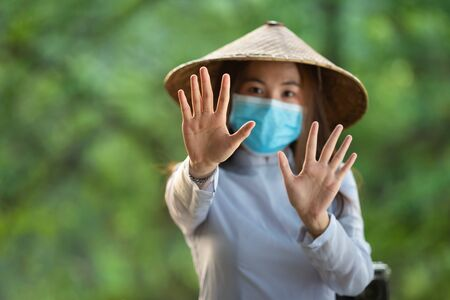 Vietnamese woman wear masks, Ao dai is famous traditional costume wear masks, concept prevent the spread ofCovid-19 Coronavirus concept