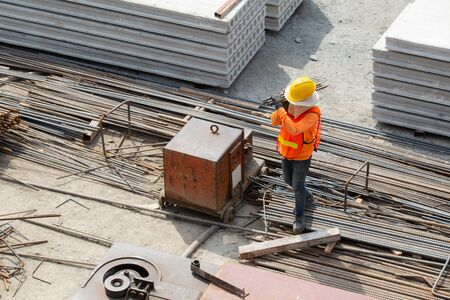 aerial view of construction workers carrying steel on construction sites