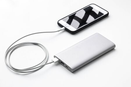 power bank and smartphone on white background.