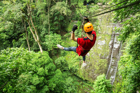 Freedom adult Man Tourist Wearing Casual Clothing On Zip Line Or Canopy Experience