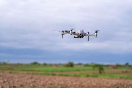 agriculture drone flight farmland survey in field 写真素材