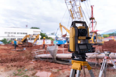 Theodolite equipment of Surveyor builder engineer during surveying work in construction site