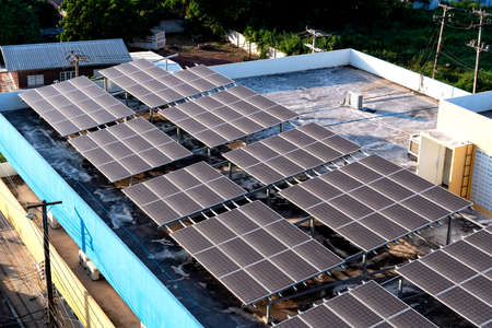 Solar panels or Solar cells on building rooftop or terrace with sun light, Can saving energy. Sun or renewable or Clean energy. Banque d'images