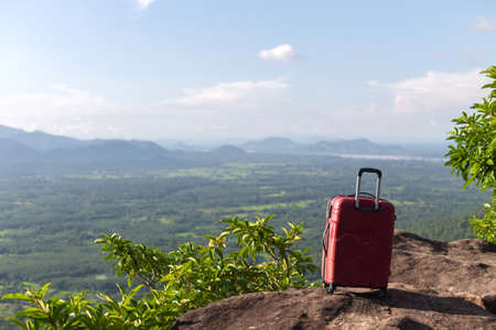 A suitcase on the mountain and the view of nature, Vacation ideas