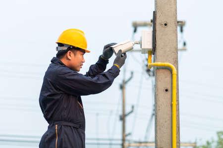 Maintenance technician checking CCTV camera
