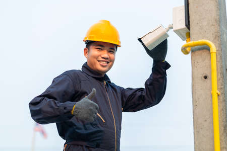 CCTV maintenance technicians give confidence during work, After-sales service concept Фото со стока