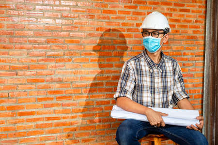 Portrait of professional engineer or architect at construction site and wear protective masks during the coronavirus outbreak.