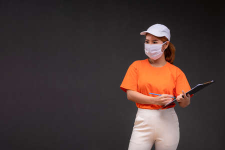Asian parcel delivery woman wear a mask