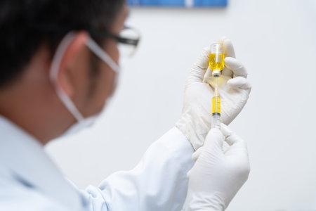 vaccine, Doctor, nurse, scientist, researcher hand in gloves holding flu, measles,  vaccine disease preparing, medicine and drug concept.