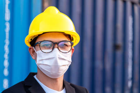 Asian foreman wear masks protect spreading of Covid 19 by wearing face masks.