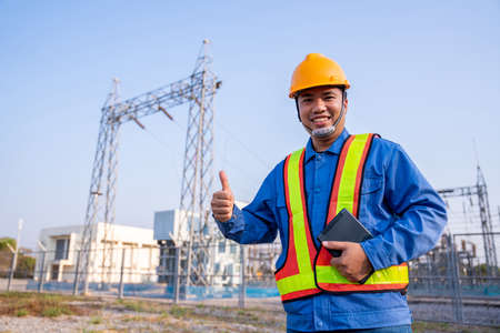 Asain electric engineer reassure wear safety  in transmission station, Concept of electric power safety. Фото со стока