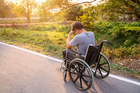 patient or disabled man have anxiety symptoms while sitting and strain on Wheelchair in spring nature, Health treatment concept.