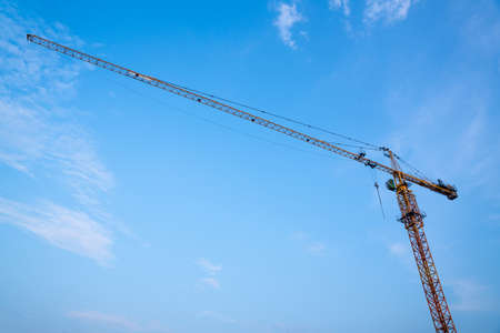 Construction crane, Industrial construction cranes and building at Construction site.