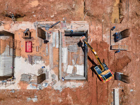 aerial view or Top View Busy worker at construction site with excavator working at Construction Site and heavy construction machine Construction Equipment