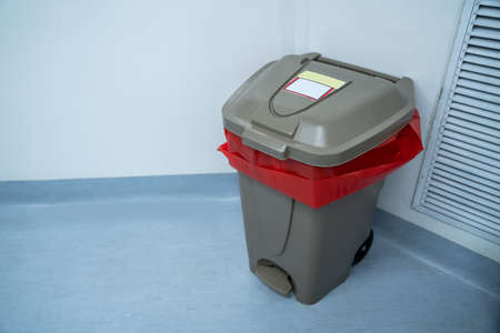 Infectious waste bin or contaminated trash in surgical operating room.