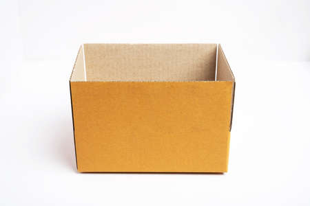 Side view of open brown cardboard box on white background.
